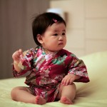 Japanese-Baby-Girl-Sitting-on-Bed